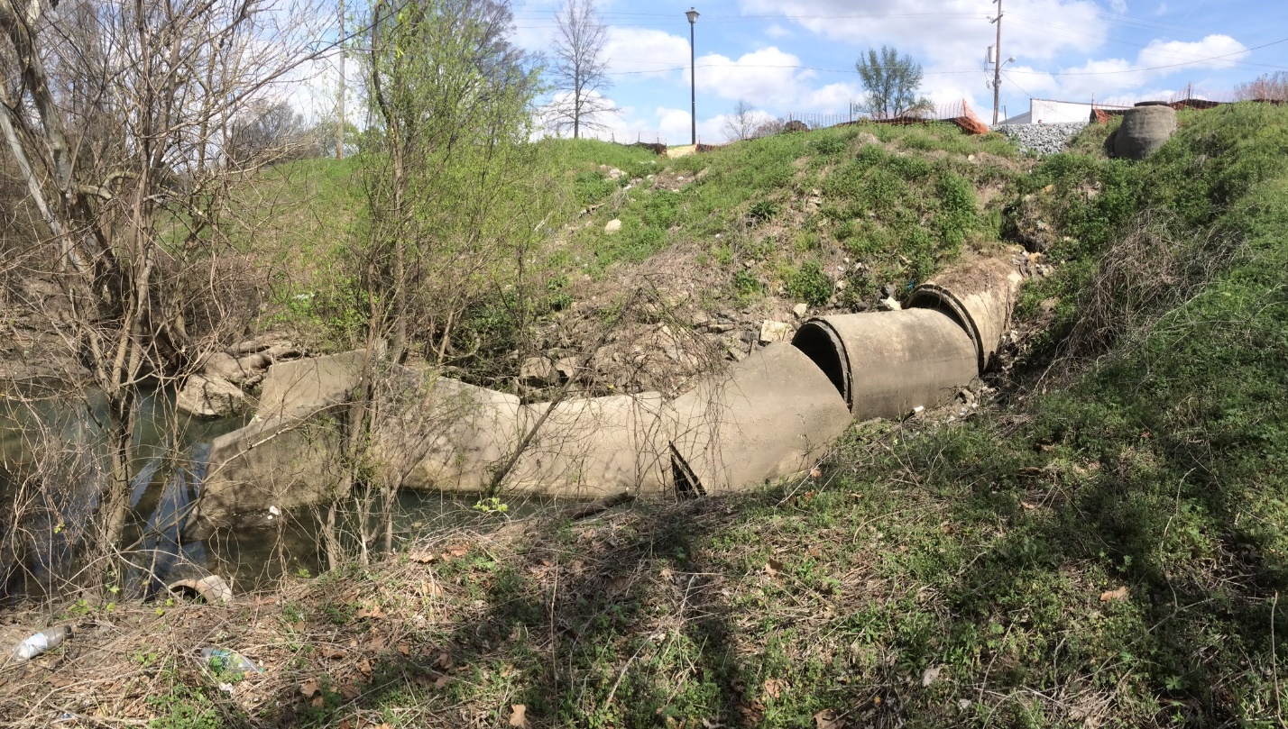 """Figure 1: """"Stream in a pipe"""" Conveying runoff from an urban area to a river. (Photo: Jonathan Page)"""
