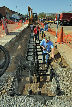 Workers for Bruce Construction from Plum install Silva cells along Colombia Avenue in Vandergrift.